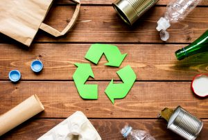 Waste,Recycling,Eco,Symbol,With,Garbage,Disposal,On,Wooden,Table